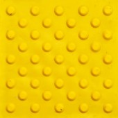 Fotografie Top view of footpath tiles. Yellow circle buttons pattern. A stop signal for blind person. Solid square background
