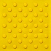Fotografie Top view of footpath tiles on a marble texture cover. Yellow circle buttons pattern. A stop signal for blind person.