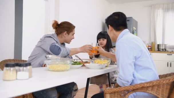Family concept. Male gay couple and daughter dining in their kitchen