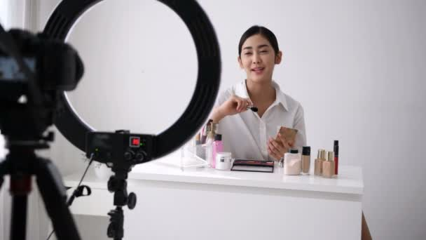 Beauty concept. Asian girls are teaching makeup over the internet.