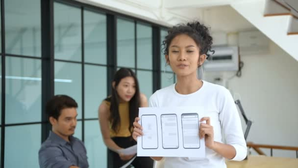 Business concept. Woman presenting a mobile application in the office. 4k Resolution.