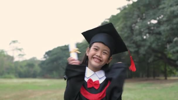 Educational concepts. Asian children are happy on their diploma, graduation day. 4k Resolution.