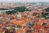aerial view of beautiful prague cityscape with rooftops, Charles Bridge and Vltava river