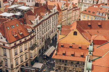 PRAGUE, CZECH REPUBLIC - JULY 23, 2018: aerial view of rooftops and people on streets in prague old town