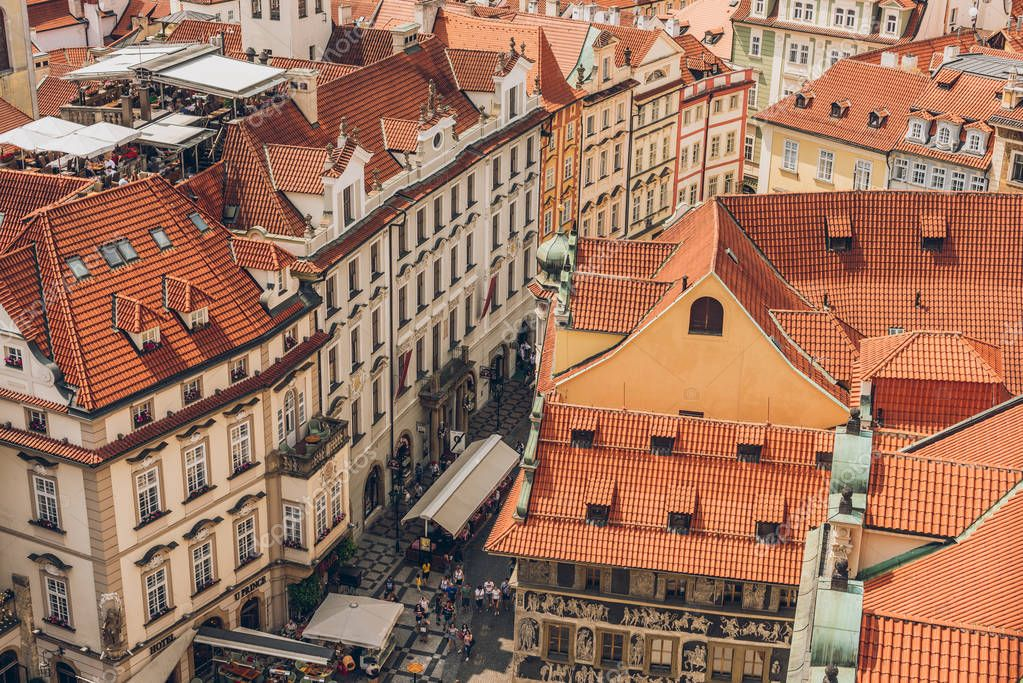 Фотообои PRAGUE, CZECH REPUBLIC - JULY 23, 2018: aerial view of rooftops and people on streets in prague old town