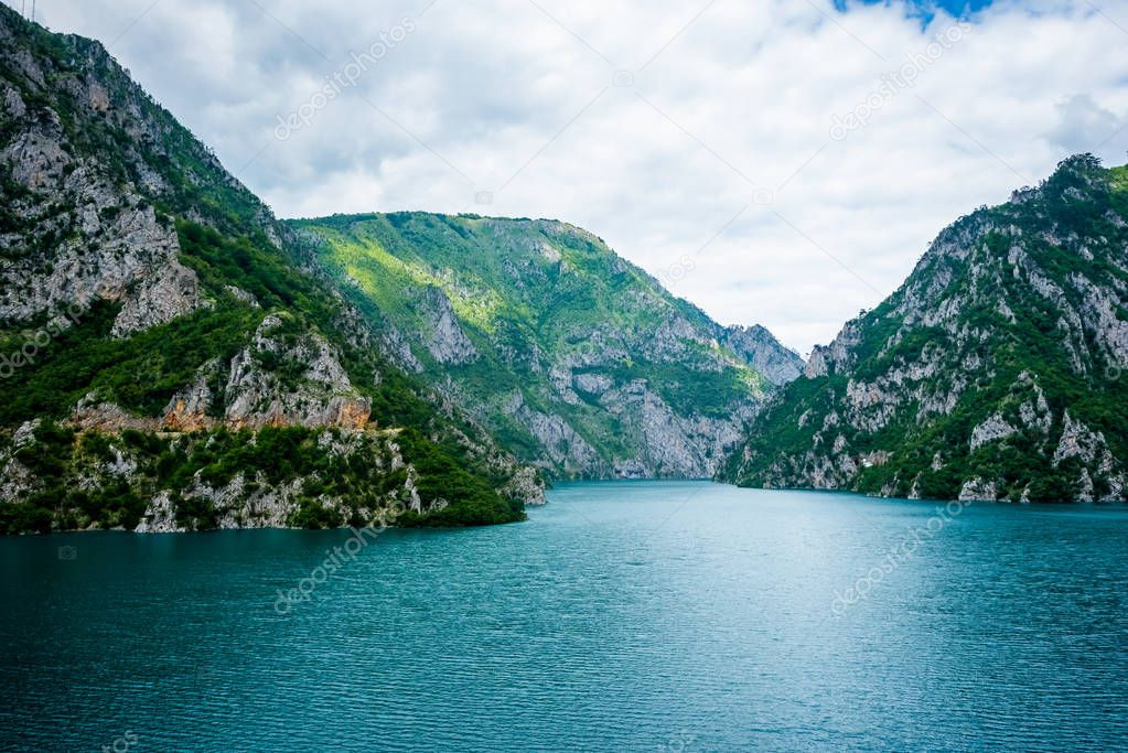 Фотообои calm blue water of Piva Lake (Pivsko Jezero) and mountains in Montenegro