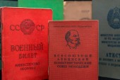 Komsomol card and military id selective focus with Multiple Soviet Union official documents of different function in the background