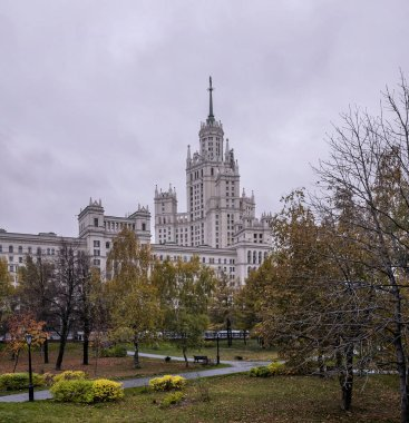 Moscow landscape with skyscraper on Kotelnicheskaya Embankment and autumn square.