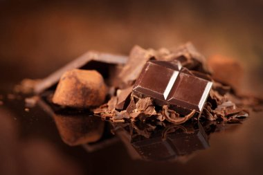 Chocolate. Assorted chocolate sweets and candies over dark backg