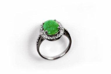 Diamond Ring/Elegance luxury ring with emerald isolated on white background