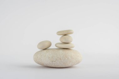 One simplicity stones cairn isolated on white background, group of five white pebbles in tower, harmony and balance stock vector