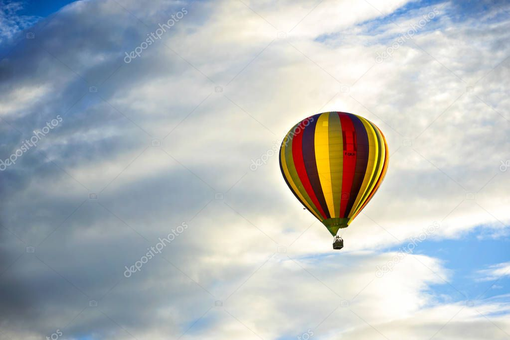 Beautiful Hot Air Balloon Against a Deep Blue Sky and Clouds.