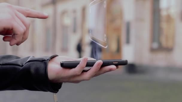 Male hands show on smartphone conceptual HUD hologram Scalability. Man with the future technology mobile holographic screen on blurred background of the university
