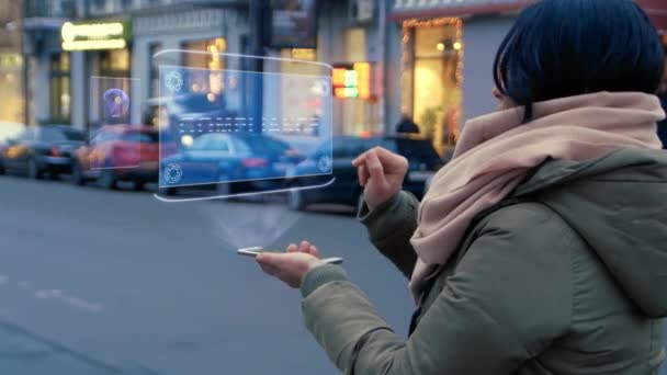 Unrecognizable woman standing on the street interacts HUD hologram with text Compliance