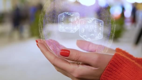 Female hands holding hologram dices