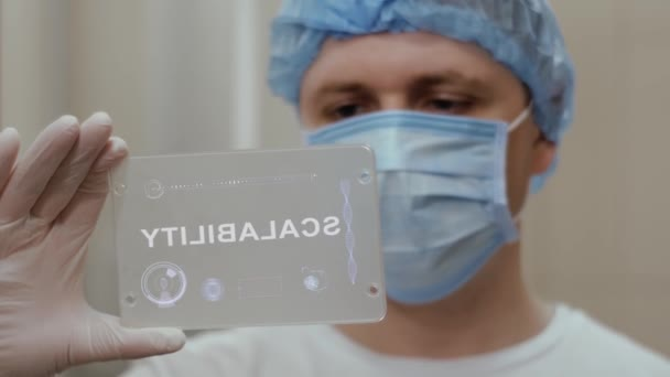 Doctor uses tablet with text Scalability