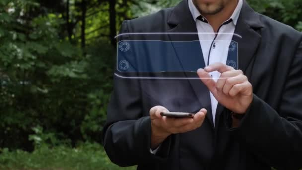 Businessman uses hologram with text Compliance