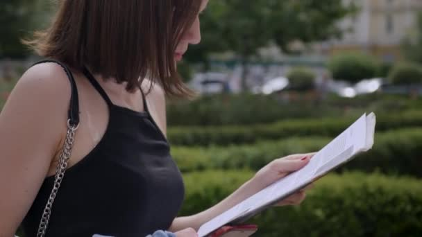 Girl looking at papers