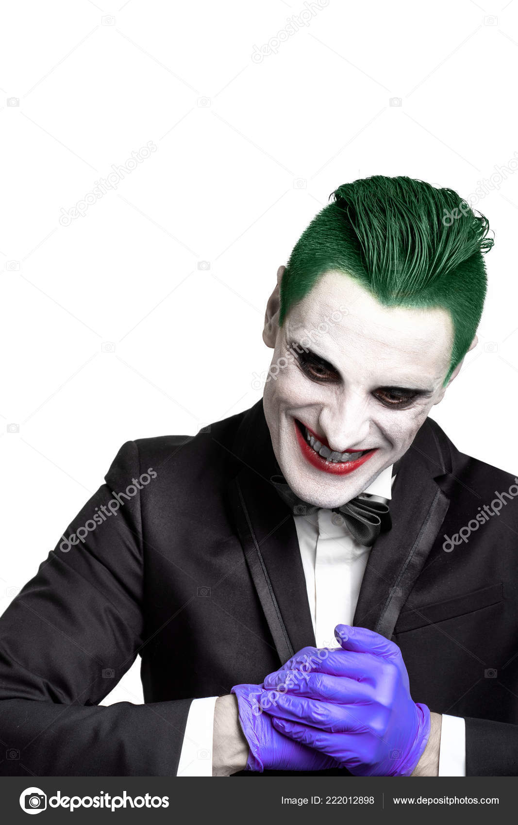 portrait of a joker. makeup for halloween. crazy image of a man in a