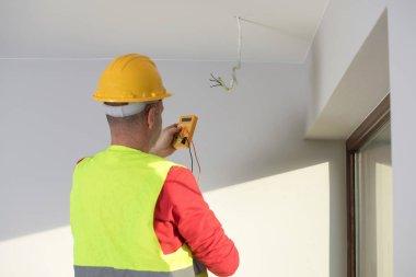 repair of electrical installations, repair of electrical installations, electrician at work