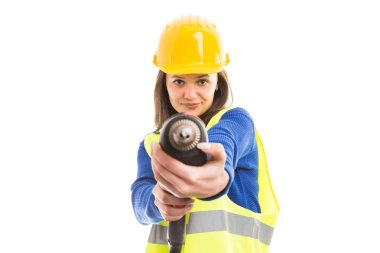 Young attractive woman engineer or architect using drilling machine as building tool work concept isolated on white background