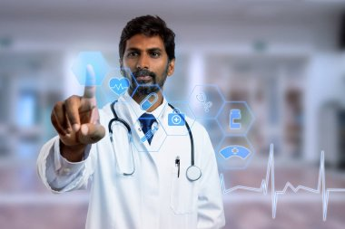 Indian doctor touching with index finger blue hexagon button on transparent screen as futuristic concept