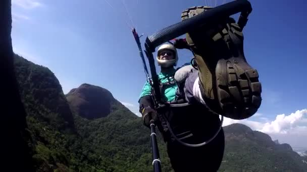 Paraglider pilot, physical handicapped, flying in their own paragliding