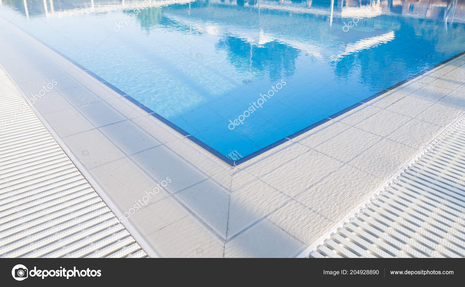 Outdoor sunny swimming pool with a beautifull clean blue water ...