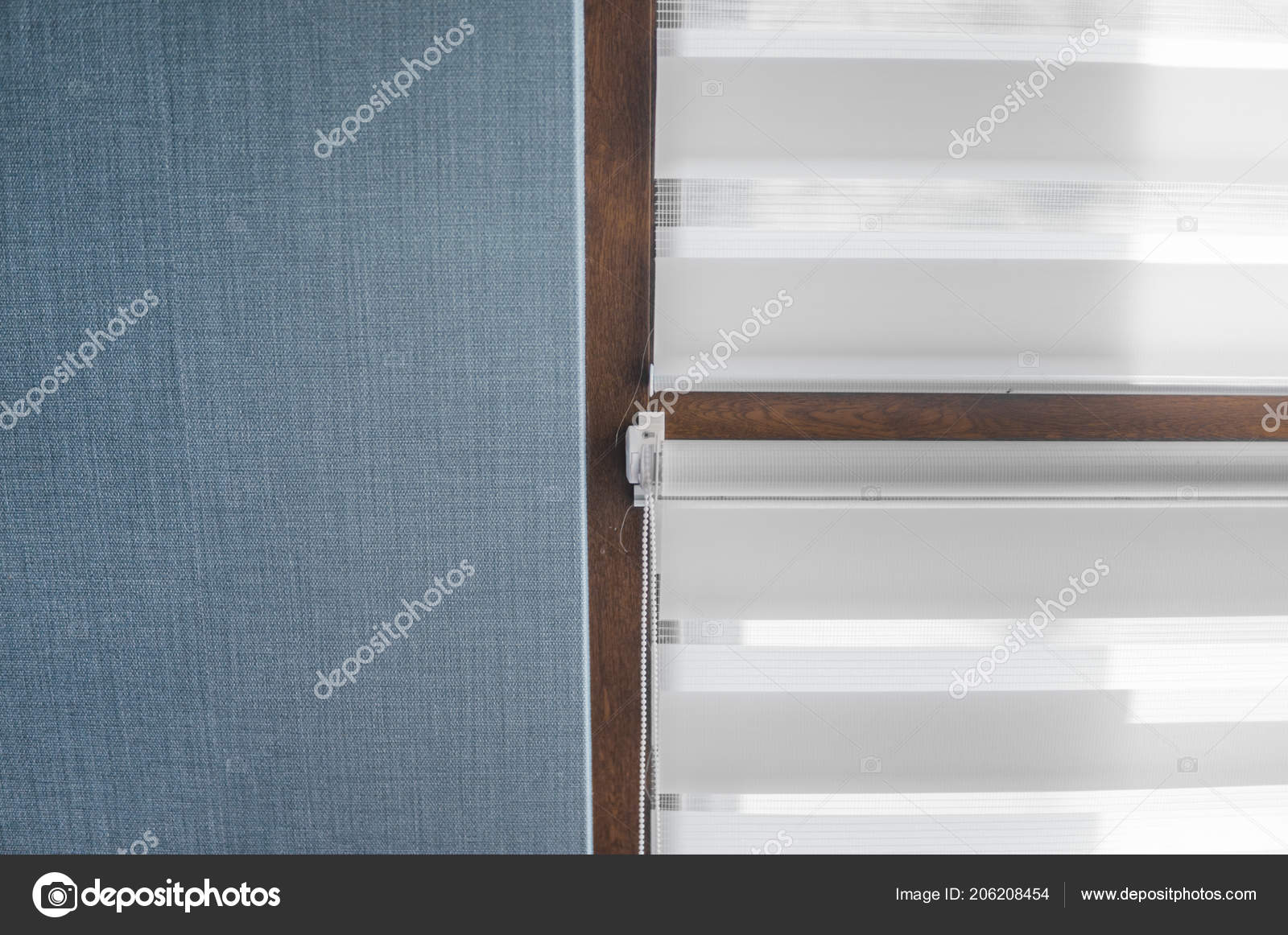 White Fabric Roller Blinds On The Plastic Window With Wood Texture In The Living Room With Blue Wall Stock Photo C Volodymyrshtun 206208454