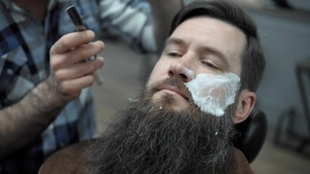 Barber Shaves Men With A Long Beard