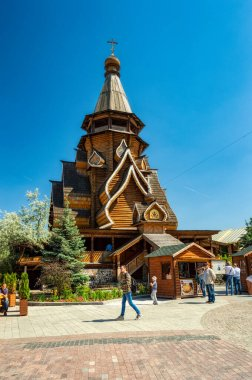 Wooden St. Nicholas Church of the Izmailovo Kremlin on a summer day against the blue sky. The Kremlin in Izmailovo and the Museum reflected ancient Russian architecture.  Moscow, Russia, June 2018