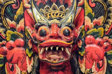 Red and Yellow Indonesian wall art - Mask with fangs