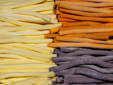 Long chewy marmalade candies of different colors.