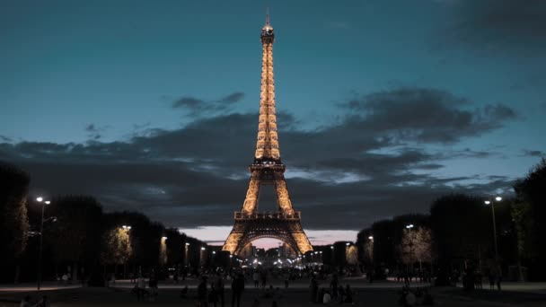 PARIS, FRANCE - AUGUST 08, 2018: Eiffel Tower in the center of the capital. View from the field of Mars. Evening, illumination is on
