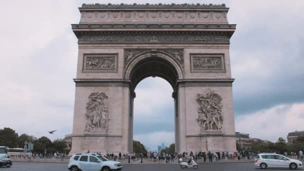 Arch of Triumph in the central part of the capital of France, Paris. Close-up slow motion with passing traffic