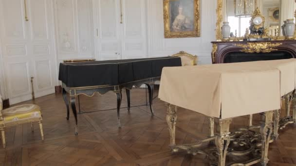 Versailles, PARIS, FRANCE- August 2018: Luxurious interior of the royal palace. Musical instruments - harpsichords, paintings and armchairs. Slow Motion