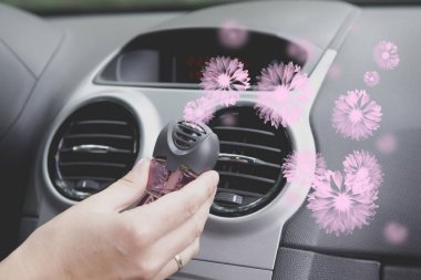 Car air freshner mounted to ventilation panel, fresh flower scent