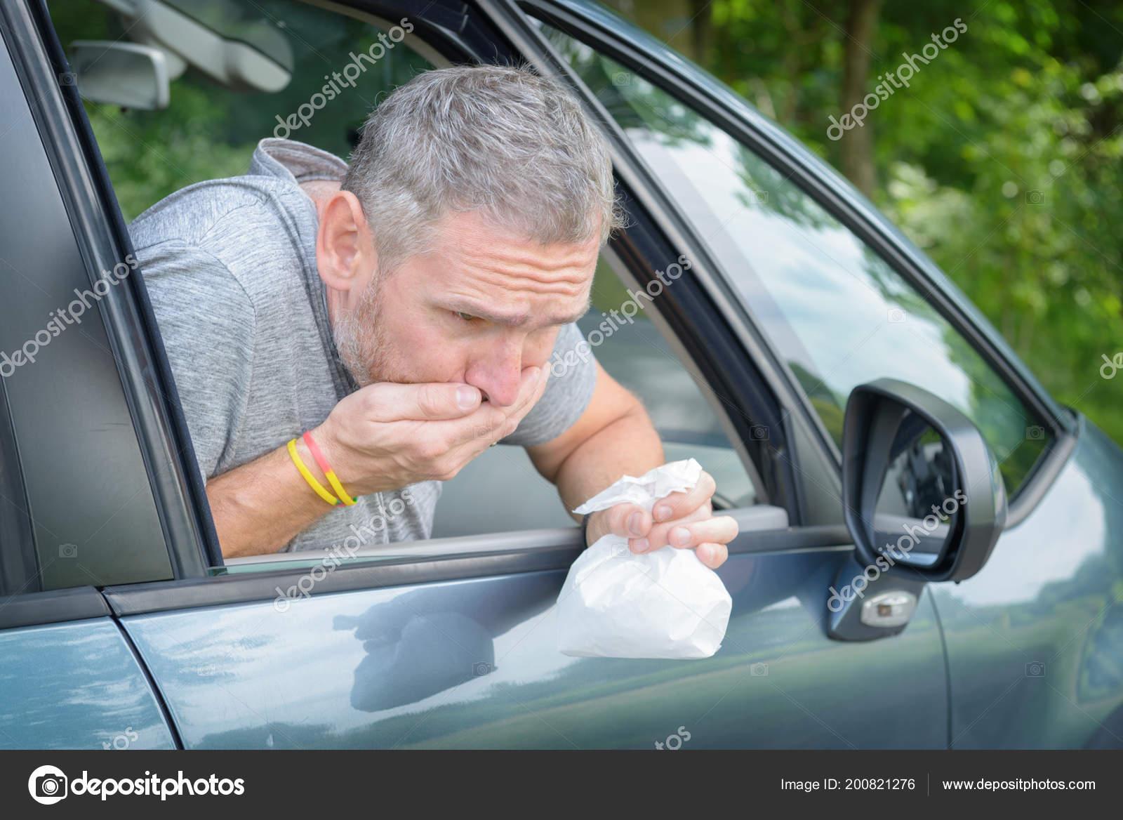 Man Suffering Motion Sickness Car Holding Sick Bag