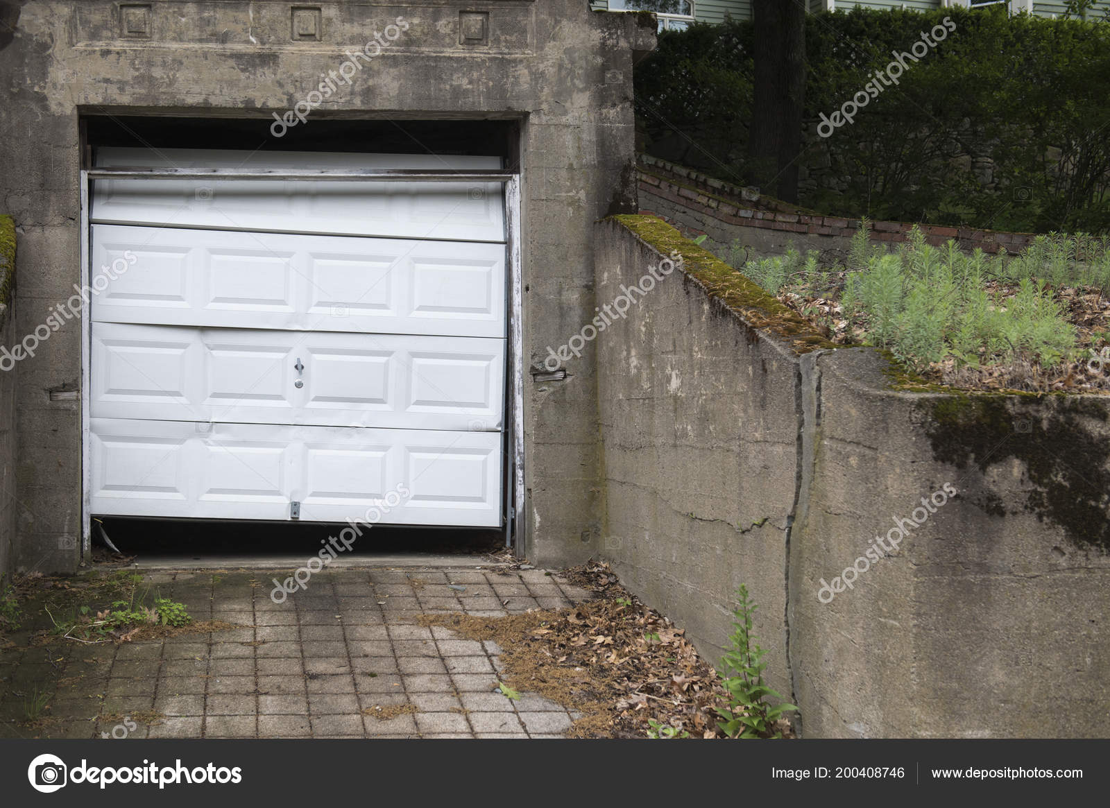 Single Garage Door Hangs Askew Dented Property Appears Dirty