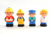 Childrens toys - figures of men. Small figures of builders, policeman, doctor. Isolated on white background.