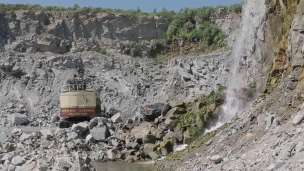 Mine excavator 01 / Mining excavator loading rocks