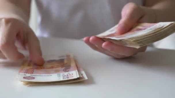The Russian five-thousandth banknotes counting hands, closeup shot