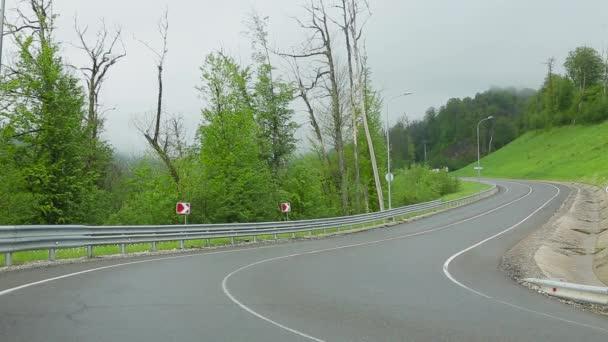 May 12, 2019, Russia, Sochi, the vicinity of Krasnaya Polyana, cars go on a serpentine