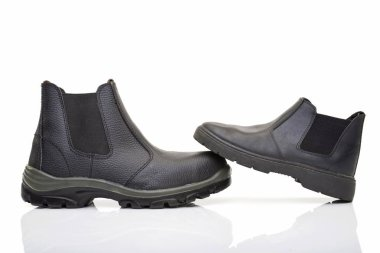 Large and small black shoe boots, different male shoes