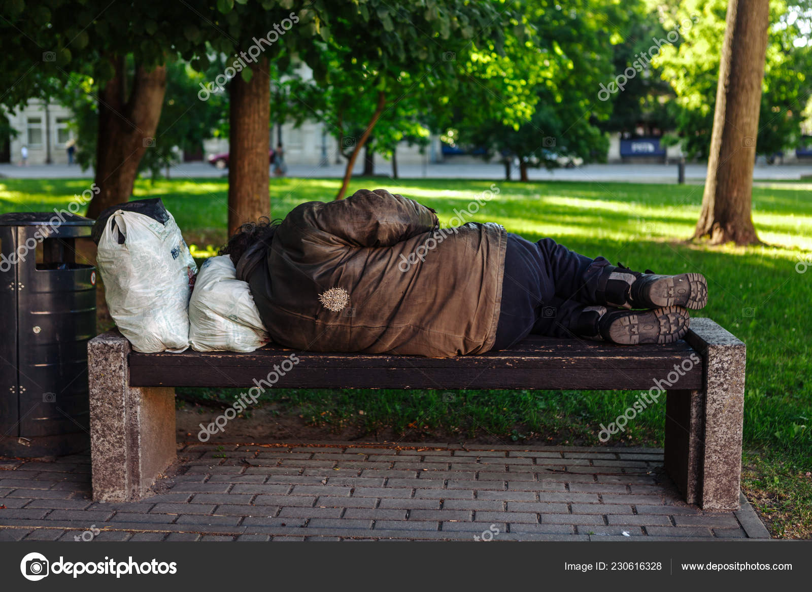 Homeless Sleeping On A Park Bench Lithuania Stock Editorial Photo
