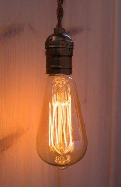Vintage working bulb lamp in wood interior