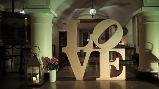 Large golden letters LOVE in the old house
