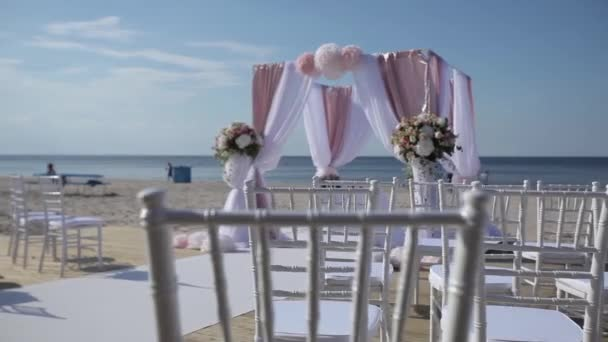 Wedding decorations from white and red flowers ceremony floristics near the sea