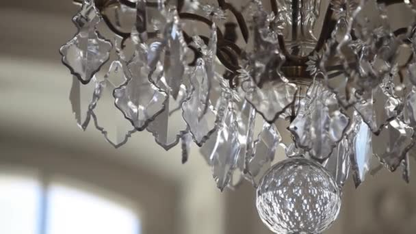 A Vintage Chandelier on white ceiling in old castle
