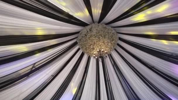 A Vintage Chandelier Under the cloth dome in the banquet hall